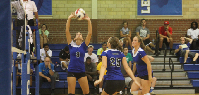 Chassity Taylor sets the ball for Ashley Reed