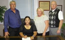Brittany Valentine (center) with parents and Women's Golf Coach, Stan Harrison