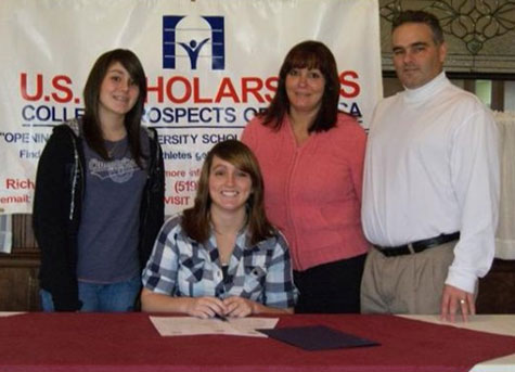 Stephanie Carr (center) with parents Joe & April Carr and sister Holly
