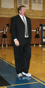 Coach Rice wearing his suit and sneakers for Coaches vs. Cancer